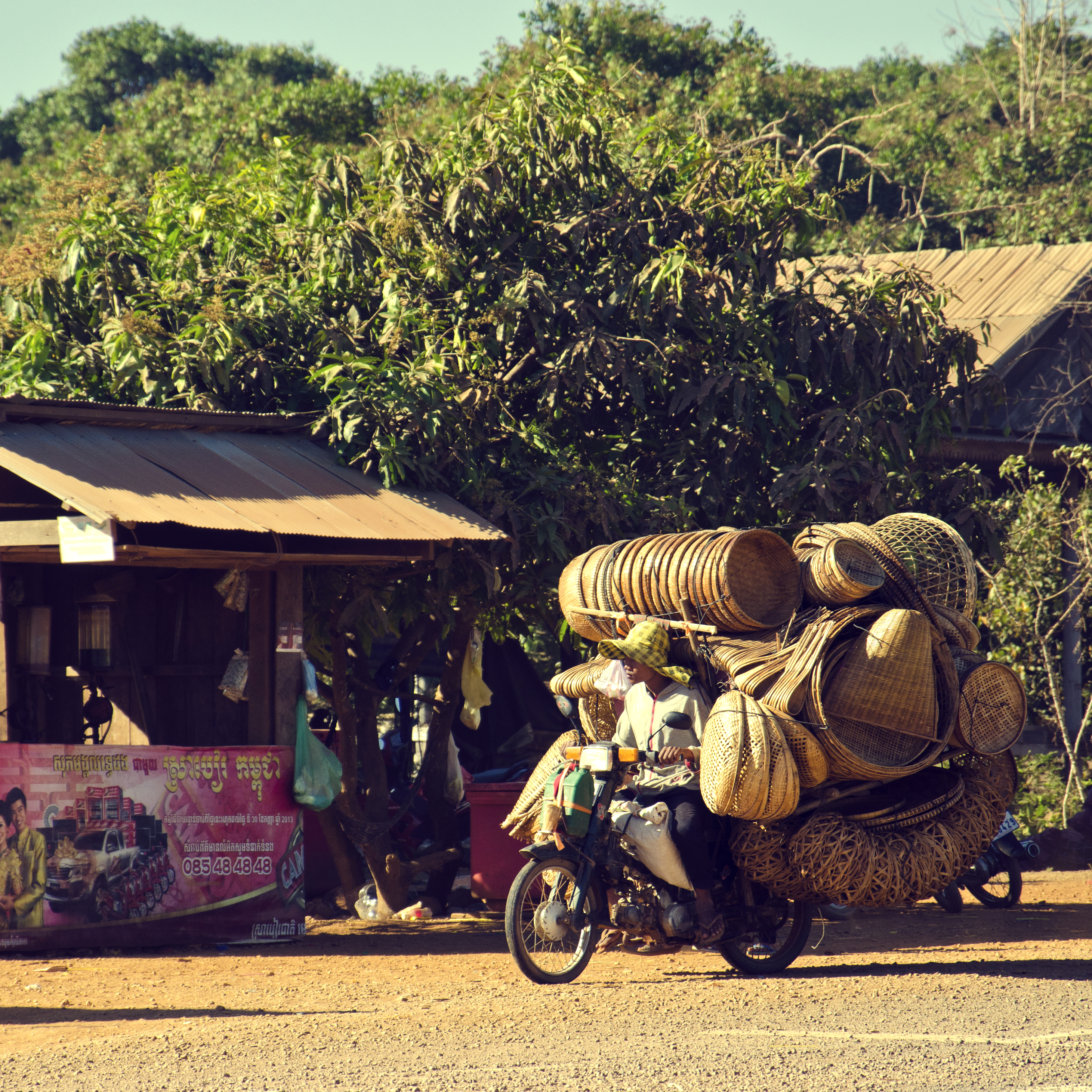Basket Seller in Lompat, Cambodia on a Honda super cub