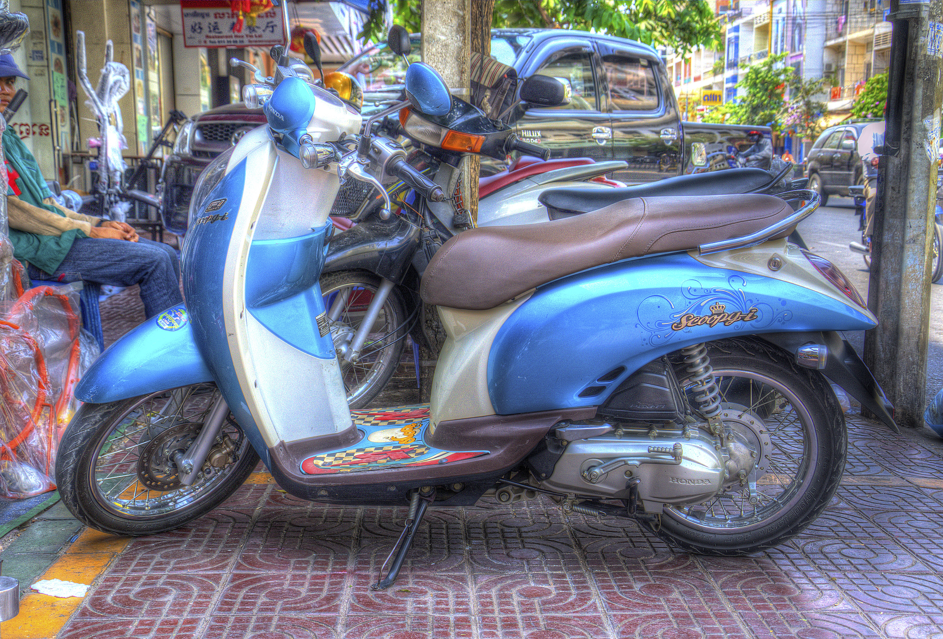 One of the ubiquitous scooters scurrying through the streets of any Southeast Asian City