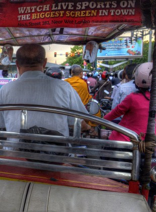 View from a Tuk Tuk at a traffic light; Phnom Penh