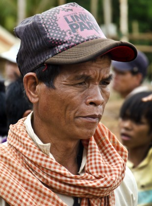 indigenous krung hilltribe man wearing a linkin park hat
