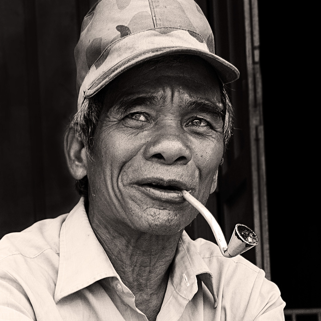highland minority man smokes a pipe
