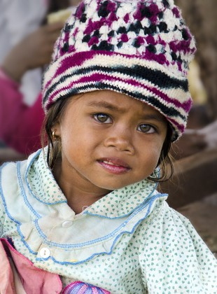 Tampuan girl with striking, light-colored eyes