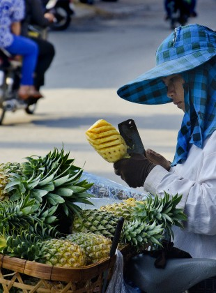 Carving a pineapple, Cambodia style