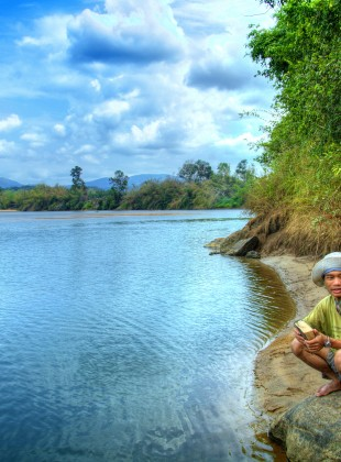 Brao man on the banks of the Sesan in Ratanakiri, Cambodia